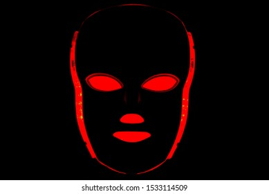 Led mask glowing red on black background