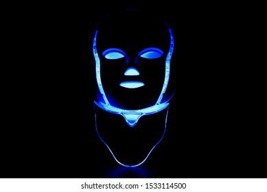 Led mask with neck glowing blue on black background