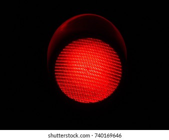 LED Red Light Traffic Light Isolated by a Black Background
