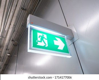 led sign in corridor point way out of resident apartment building, Fire warning exit with arrow symbol sign box light Emergency Exit