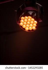 led stage light with orange color hue