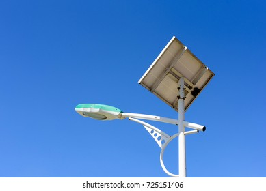 LED street light post with solar cell panel with clear sky background