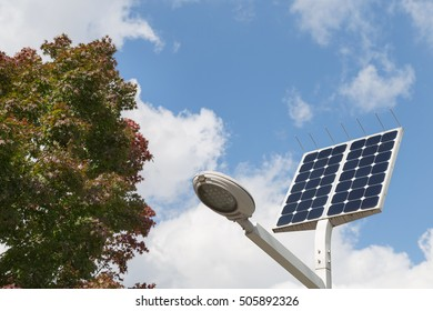 LED street light with solar cell and blue sky background on the street