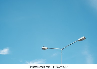 LED street lighting with soft cloudy on blue sky background with copy space