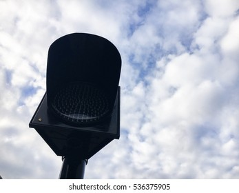 LED traffic light ,orange blink on the road with cloud sky is background.