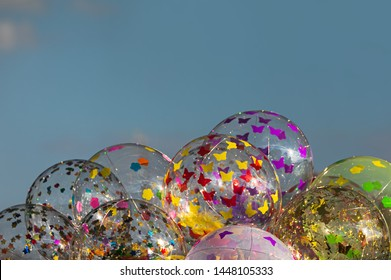LED transparent balloons with with butterflies against a gray sky