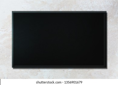 Led tv or blackboard on gray concrete wall          - Image