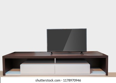 LED TV on wood table modern style with gray wall background