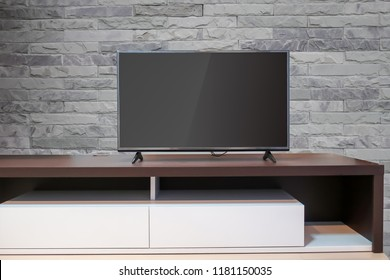 LED TV on wood table modern style with  stone wall background