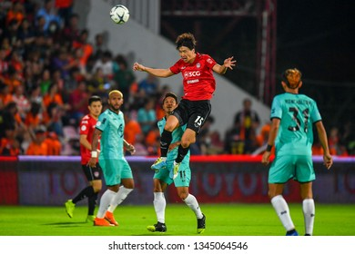 Lee Ho no.15 (red)of SCG Muangthong United in action during The Football Thai League match between SCG Muangthong United and PT Prachuap F.C.at SCG Stadium on February24,2019 in Nonthaburi, Thailand