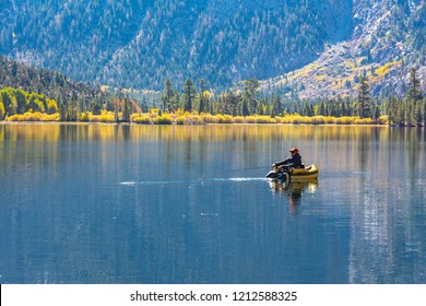 Lee Vining, CA. USA. October, 25, 2018. Fly fisherman fishing for trout on Silver Lake during fall, an Eastern Sierra Lake.