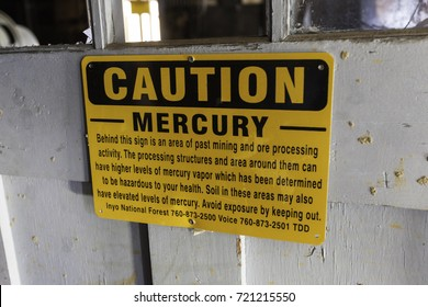 LEE VINING, CALIFORNIA - SEPTEMBER 3, 2017: Sign warns of mercury hazard present in old mine equipment at an abandoned gold mine