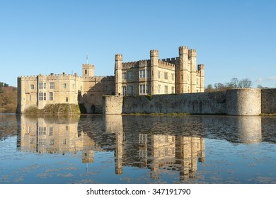 Leeds Castle across the moat with reflection.