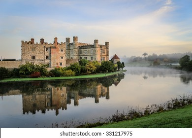 Leeds Castle, Kent, England, at dawn, with mist on the lake.