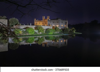 Leeds Castle, Kent, England, at night, reflected in the moat
