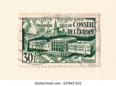 Leeds, England - April 26 2018: An old green vintage french postage stamp with an image the council or europe building and strasbourg