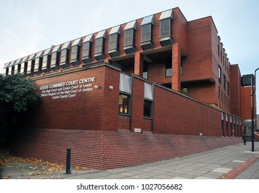 Leeds, England - January 18, 2018: man walking past the entrance to leeds combined magistrates and crown court building