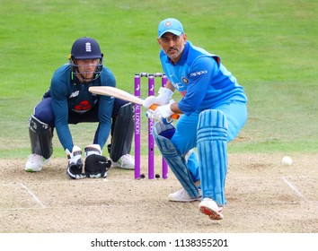 LEEDS, ENGLAND - JULY 17: Jos Buttler and MS Dhoni during the 3rd Royal London One day International match between England and India at Headingley Cricket Ground on July 17, 2018 in  England.