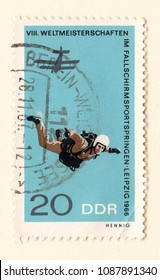 Leeds, England - May 10 2018: An old blue east german postage stamp commemorating a skydiving event in Leipzig in 1966