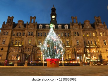 Leeds, England - November 13 2018: the annual christmas tree in city square outside the old post office building at night