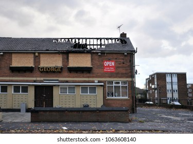 Leeds, England - September 24, 2017: A closed public house stands derelict and boarded on a housing estate in hunslet leeds after being attacked by vandals.