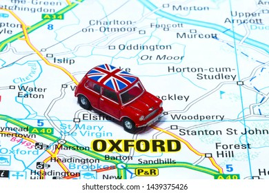 Leeds England UK June 29 2019 conceptual image of a red toy car placed on a map showing the road layout for Oxford - Editorial