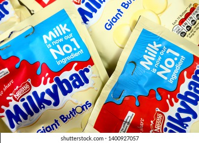 Leeds England UK November 27 2018 Packets of nestle milky bar giant buttons isolated on a white background - Editorial