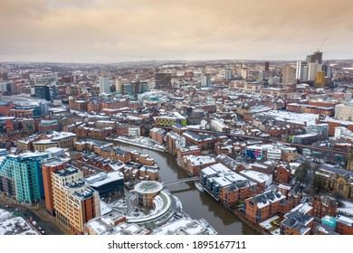 Leeds UK, 16th Jan 2021: Aerial photo of the area in the Leeds City Centre known as Brewery Wharf showing snow covered apartment buildings along side the Leeds and Liverpool canal in the winter time