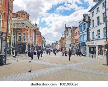 LEEDS, UK - APRIL 29, 2018: People shopping on  Briggate, one of the main shopping street in Leeds, West Yorkshire, UK.