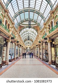 LEEDS, UK - APRIL 29, 2018:  Shoppers walking through County Arcade in the Victoria Quarter in Leeds. The Victoria Quarter is largely populated by upmarket retailers and was designed in 1900.