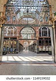 LEEDS, UK - AUGUST 1, 2018: People visit shops of Victoria Quarter in Leeds, UK. The arcaded streets of Victoria Quarter near Briggate street have many upmarket brand shops.