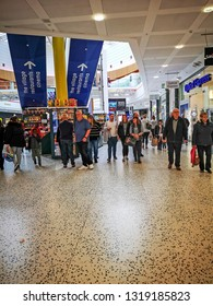 LEEDS, UK - FEBRUARY 19, 2019: Shoppers walking through the indoor mall of White Rose Centre on a busy school half term.