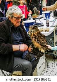LEEDS, UK - FEBRUARY 19, 2019: An owl on display in the indoor mall of White Rose Centre on a busy school half term.
