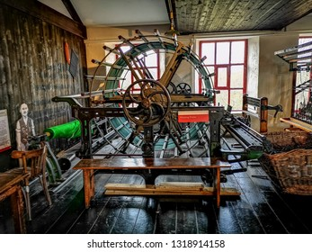 LEEDS, UK - FEBRUARY 21, 2019: Historic machinary Armley Mills. The Leeds Industrial Museum at Armley Mills is a museum of industrial heritage housed in what was once the world's largest woollen mill.