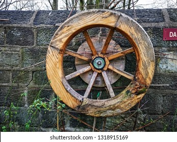 LEEDS, UK - FEBRUARY 21, 2019: Wooden wheel, Armley Mills. The Leeds Industrial Museum at Armley Mills is a museum of industrial heritage housed in what was once the world's largest woollen mill.