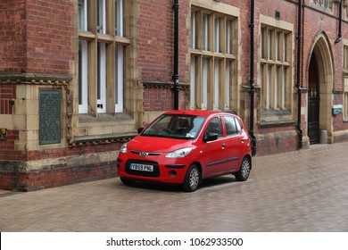 LEEDS, UK - JULY 11, 2016: Hyundai i10 red mini hatchback car parked in Leeds, Yorkshire, UK. There were 30.9 million cars registered in the UK in 2016.