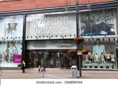 LEEDS, UK - JULY 12, 2016: People walk by Topshop Topman fashion store in Leeds, UK. Topshop is a British fashion retailer owned by Arcadia Group.