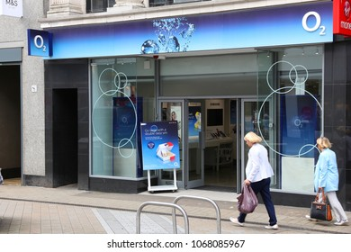 LEEDS, UK - JULY 12, 2016: Person visits O2 mobile phone shop in Leeds, UK. There are 89.9 million mobile phone subscribers in the UK.
