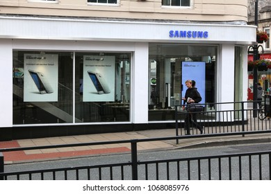 LEEDS, UK - JULY 12, 2016: People walk by Samsung electronics shop in Leeds, UK. Samsung is a multinational conglomerate focusing on electronics industry.