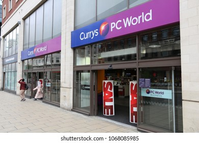 LEEDS, UK - JULY 12, 2016: People walk by Currys PC World computer shop in Leeds, UK. The store chain is owned by Dixons Carphone, a British group.