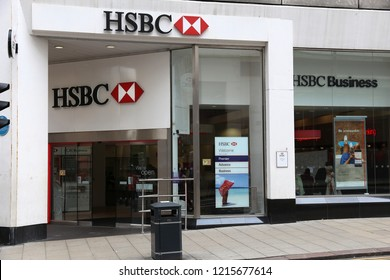 LEEDS, UK - JULY 12, 2016: People walk by HSBC Bank in Leeds, UK. HSBC is one of largest bank groups, holding assets of USD 2.69 trillion worldwide (2012).