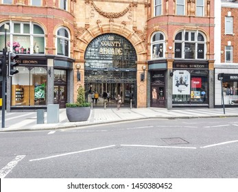 LEEDS, UK - JULY 13, 2019: Entrance to the shops of County Arcade in Leeds, UK. The arcaded streets of Victoria Quarter near Briggate street have many upmarket brand shops