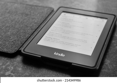 LEEDS, UK - JULY 16: Amazon Kindle paper white e book reader, image processed in black and white. July 16, 2014 in Leeds, UK.