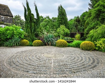 LEEDS, UK - JUNE 02, 2019: Pavement maze at York Gate Garden, Adel, Leeds, West Yorkshire. York Gate is widely recognized as an outstanding example of 20th century garden design.