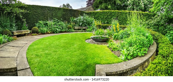 LEEDS, UK - JUNE 02, 2019: Sybil's garden at York Gate Garden, Adel, Leeds, West Yorkshire. York Gate is widely recognized as an outstanding example of 20th century garden design.