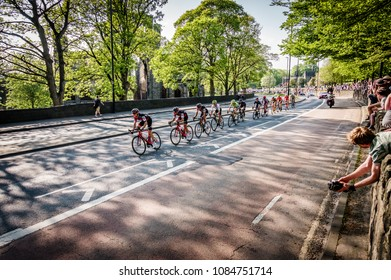 Leeds, UK - May 06, 2018: Cyclists taking part in Stage 4 of the Tour de Yorkshire pass Kirkstall Abbey in Leeds.