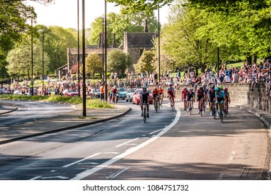 Leeds, UK - May 06, 2018: Cyclists taking part in Stage 4 of the Tour de Yorkshire pass cheering crowds in Leeds.