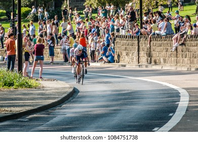Leeds, UK - May 06, 2018: Two cyclists coming round the bend at Kirkstall in stage 4 of the Tour de Yorkshire.