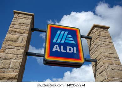 Leeds, UK: May 20, 2019: Commercial sign of ALDI store. Aldi is a large discount supermarket chain based in Germany