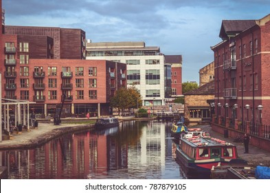 Leeds, The United Kingdom. 29-09-2017: A view at modern houses by the river of Aire in Leeds.
